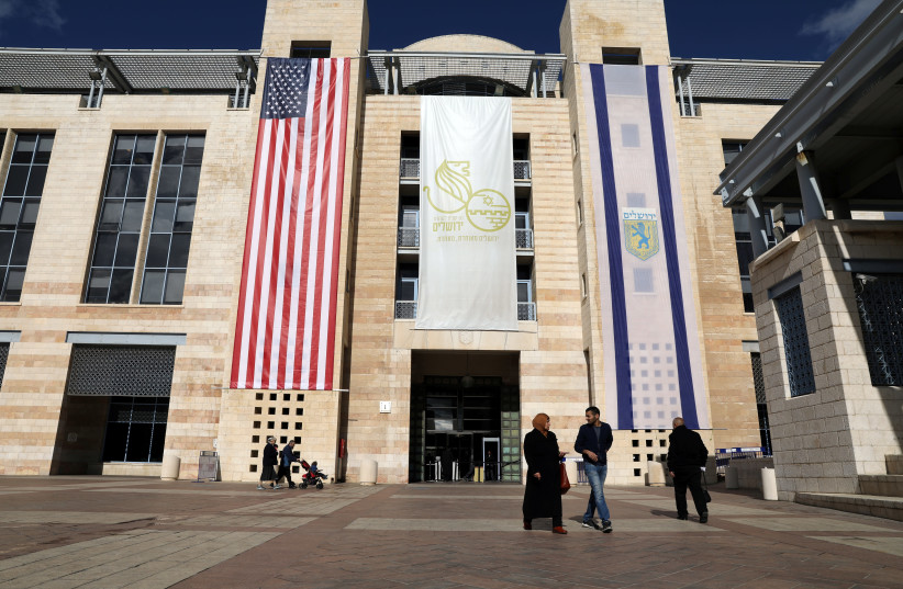 City Hall in Jerusalem drapped in an American flag in 2017 (photo credit: REUTERS)