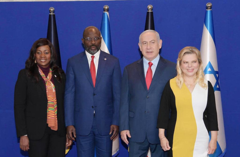 Prime Minister Benjamin Netanyahu and his wife with Liberian President George Weah and his wife  (photo credit: PMO)
