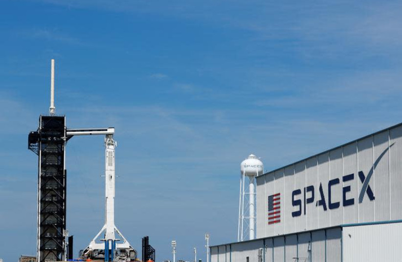 A SpaceX Falcon 9 carrying the Crew Dragon spacecraft sits on launch pad 39A prior to the uncrewed test flight to the International Space Station from the Kennedy Space Center in Cape Canaveral, Florida, U.S., March 1, 2019 (photo credit: REUTERS/MIKE BLAKE)