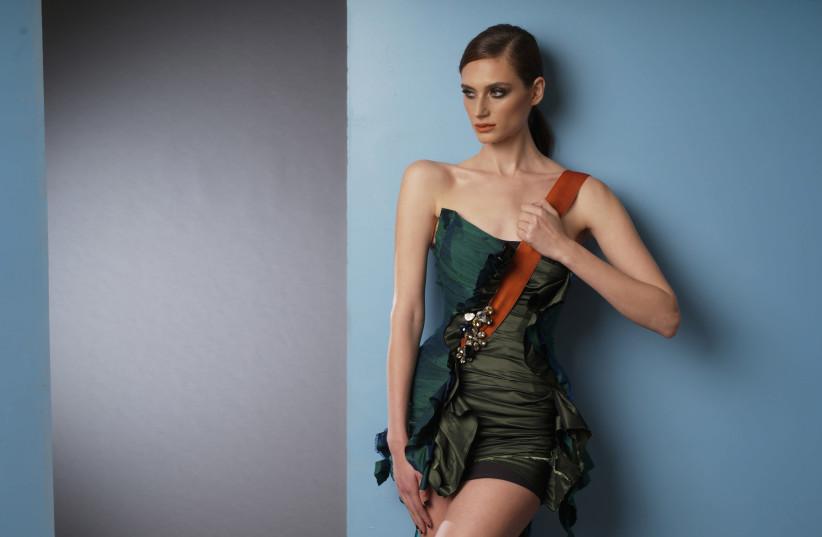 Noam Frost models items from Efrat Kalig's latest collection (photo credit: DVIR KAHLON)