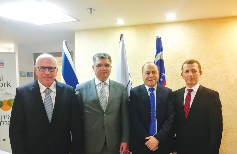 FROM LEFT: Amir Shani, Dilshod Akhatov, Silvan Shalom and Said Rustamov meet at a roundtable meeting to promote a series of bilateral commercial and economic relationships.  (photo credit: Courtesy)