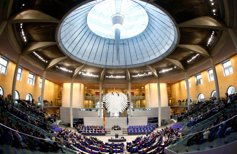 German Chancellor Angela Merkel addresses the lower house of parliament Bundestag in Berlin, Germany December 12, 2018 (photo credit: REUTERS)