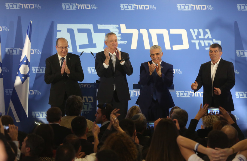 Moshe Ya'alon, Benny Gantz, Yair Lapid and Gabi Ashkenazi announce the formation of their joint party, Blue and White, in Tel Aviv on February 21st, 2019 (photo credit: MARC ISRAEL SELLEM/THE JERUSALEM POST)