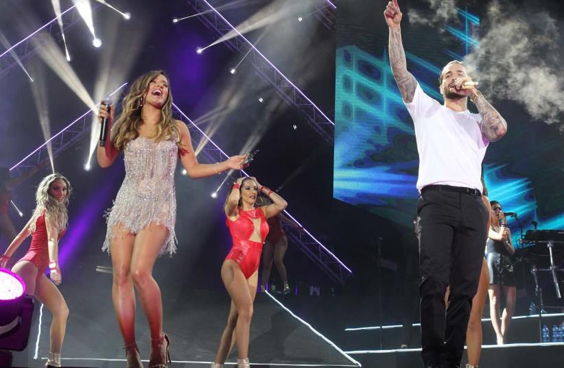 Maluma and Israeli singer Eden Ben-Zaken perform in Tel Aviv last year. (photo credit: OR GHEFEN)