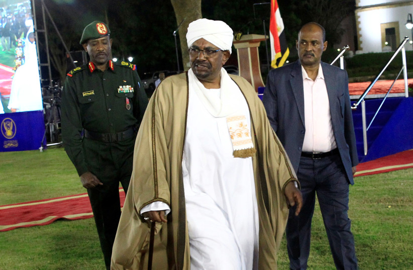 Sudan's President Omar al-Bashir leaves after delivering a speech at the Presidential Palace in Khartoum, Sudan February 22, 2019 (photo credit: MOHAMED NURELDIN ABDALLAH/REUTERS)