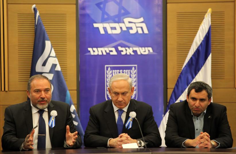 Benjamin Netanyahu (C), Avigdor Liberman (L) and Ze'ev Elkin (R), during a meeting between the Likud and Yisrael Beytenu parties (photo credit: MARC ISRAEL SELLEM/THE JERUSALEM POST)