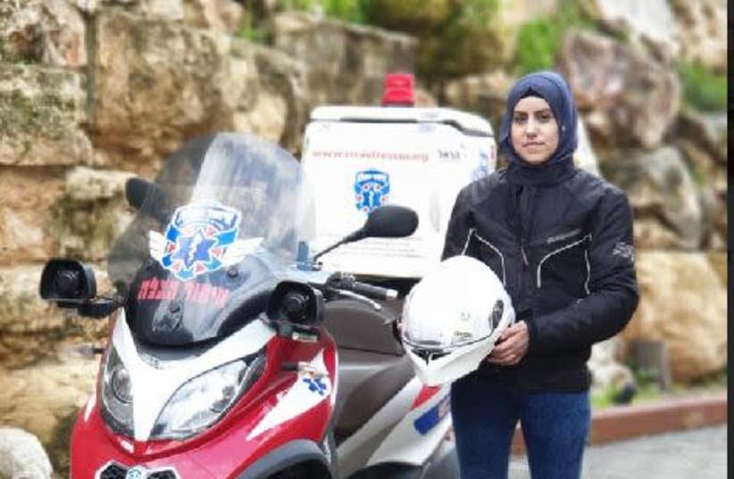 Sanaa Mahameed, first  Muslim woman to ride a medical motorcycle   (photo credit: MAAYAN JAFFE-HOFFMAN)