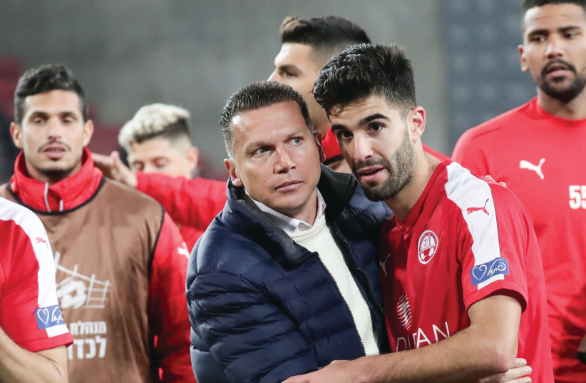 Hapoel Beersheba coach Barak Bachar (center) congratulates his players after the club recorded its third consecutive Premier League victory with a 2-0 result over visiting Hapoel Haifa on Monday night. (photo credit: DANNY MARON)