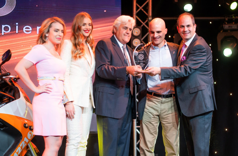 Jay Leno accepts the Humanitarian Award. (From Left) Actress Renée Willett, Esti Ginzburg, Jay Leno, Marc Gerson, Eli Beer. the 1st Annual Los Angeles Gala for Friends of United Hatzalah. (photo credit: Courtesy)