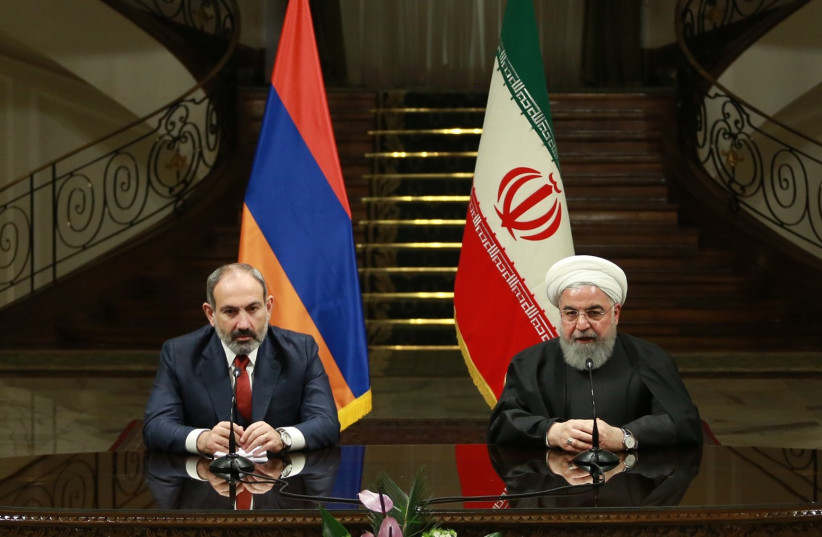 Iranian President Hassan Rouhani (R) and Prime Minister of Armenia, Nikol Pashinyan (L) hold a joint press conference following their meeting at Sadabad Complex in Tehran, Iran on February 27, 2019 (photo credit: IRANIAN PRESIDENCY HANDOUT/ANADOLU AGENCY VIA AFP)