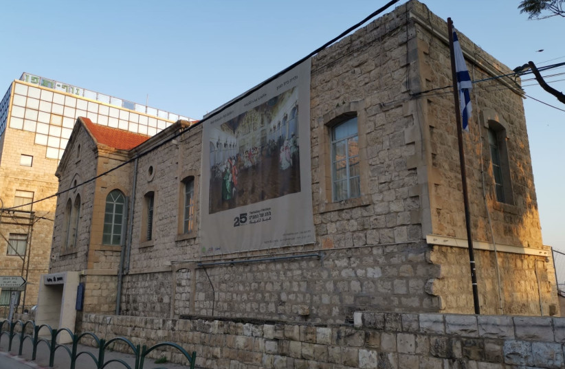 The Israeli flag outside of the Beit Ha'Gefen Arab-Jewish center in Haifa (photo credit: SHERI OZ)