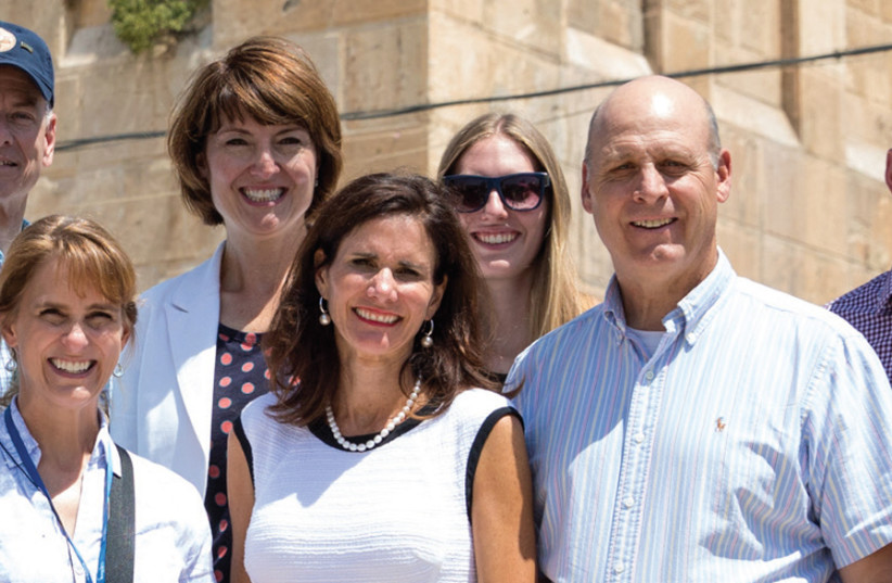 IN HEBRON with (clockwise from left to right): Former rep. Steve Russell (R-Oklahoma); Rep. Cathy McMorris Rodgers (R-Washington); daughter Hannah Lankford and Sen. James Lankford (R-Oklahoma); Brian Rodgers, spouse of Rep. McMorris Rodgers; and Cindy Russell, spouse of Rep. Russell. (photo credit: KATE MAGEE PHOTOGRAPHY)