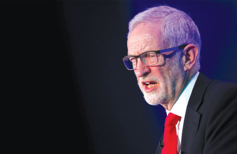 JEREMY CORBYN, leader of the Labour Party, gives a speech in London last month. (photo credit: HANNAH MCKAY/ REUTERS)