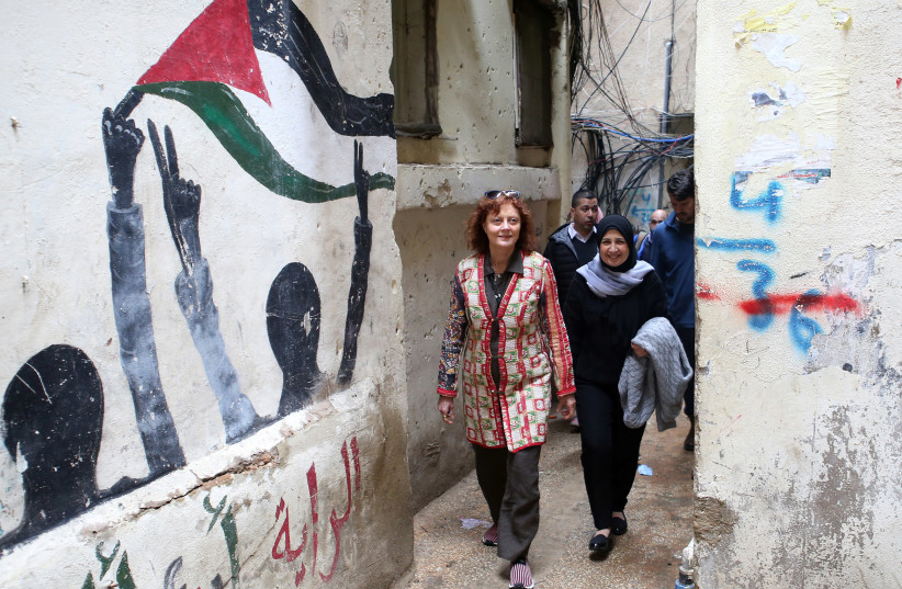 Hollywood actress and social activist Susan Sarandon walks with Mariam Shaar, a Palestinian entrepreneur in Burj al-Barajneh refugee camp in Beirut, Lebanon March 4, 2019. (photo credit: MOHAMED AZAKIR / REUTERS)