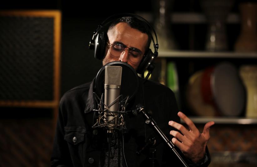 Bashar Murad in a studio (REUTERS/Ammar Awad) (photo credit: REUTERS/AMMAR AWAD)