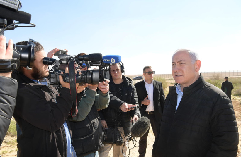 Prime Minister Benjamin Netanyahu on the Sinai border, March 7th, 2019 (photo credit: AMOS BEN-GERSHOM/GPO)