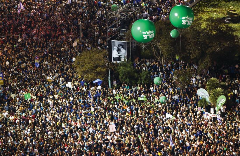 Left wing protesters in Tel Aviv (photo credit: BAZ RATNER/REUTERS)