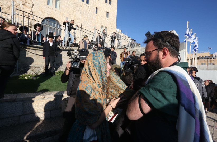 A standoff between a Orthodox man and a member of Women of the Wall takes place at the Western Wall on Friday morning. (photo credit: MARC ISRAEL SELLEM/THE JERUSALEM POST)