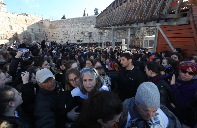Women of the Wall clashing with Orthodox worshipers (photo credit: MARC ISRAEL SELLEM)