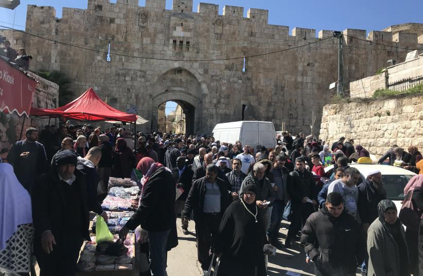 Thousands leave Jerusalem's Lions Gate after prayers Friday (photo credit: SETH J. FRANTZMAN)