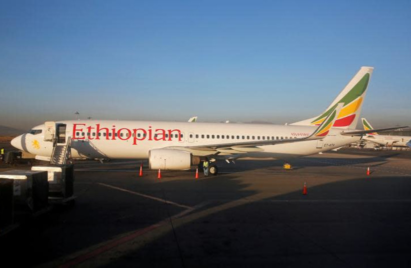 Workers service an Ethiopian Airlines Boeing 737-800 plane at the Bole International Airport in Ethiopia's capital Addis Ababa, January 26, 2017 (photo credit: REUTERS)