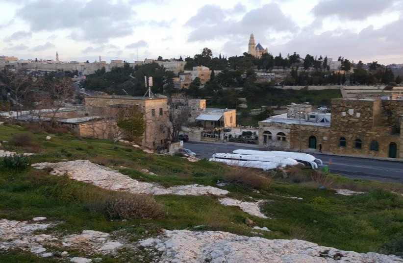 A view of Jerusalem's Valley of Hinnom with Hebron Road in the foreground and Mount Zion in the background taken from near the First Station complex (photo credit: BEN BRESKY)