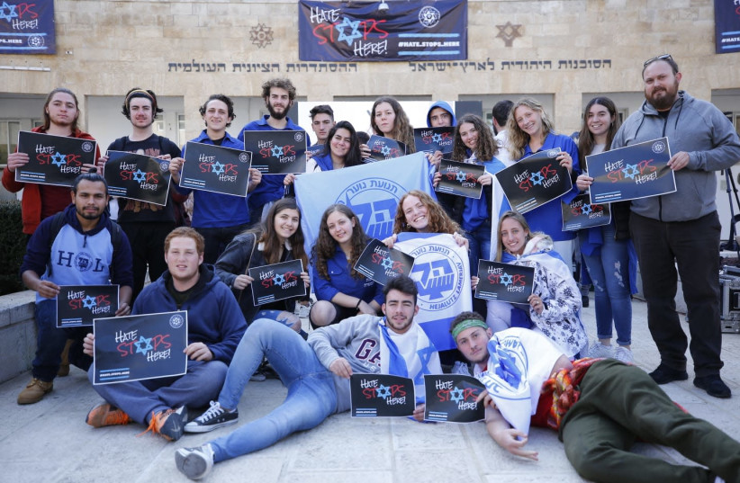 Youth taking part in the Hate Stops Here day of protests  (photo credit: ELAD KARMI)