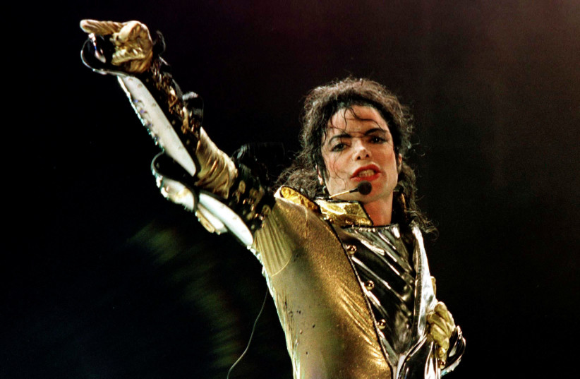 """U.S. popstar Michael Jackson performs during his """"HIStory World Tour"""" concert in Vienna, July 2, 1997. (photo credit: LEONHARD FOEGER / REUTERS)"""