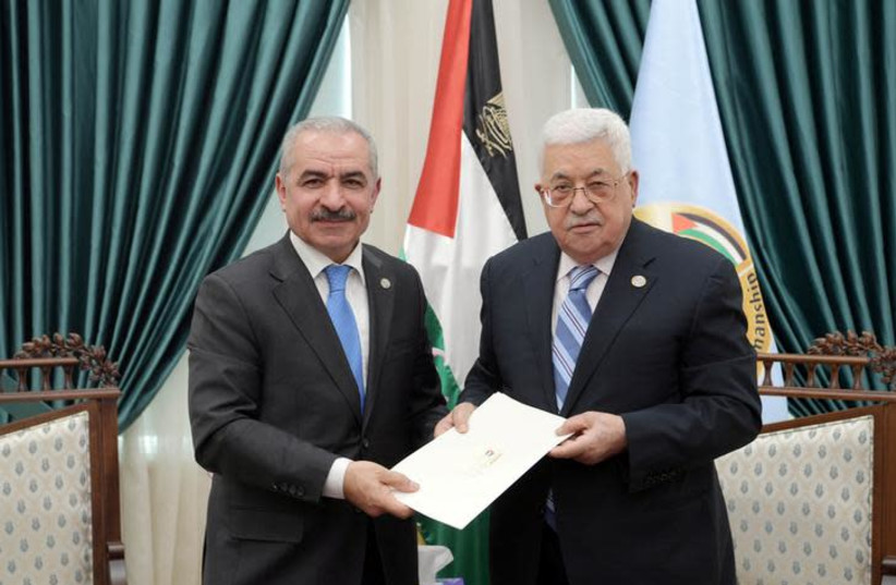 Senior Fatah official Mohammad Shtayyeh receives a designation letter from Palestinian President Mahmoud Abbas to form a new Palestinian government, in Ramallah (photo credit: REUTERS)