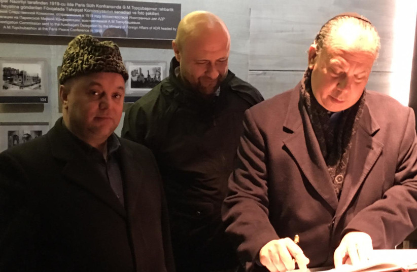 From right to left: Rabbi Marc Schneier, Bishop Robert Stearns and an Imam from the trip to Azerbaijan at the Guba Genocide Memorial (photo credit: THE FOUNDATION FOR ETHNIC UNDERSTANDING (FFEU))