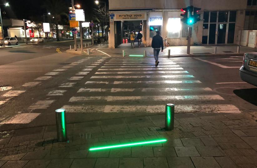 Tel Aviv-Yafo Municipality installs sidewalk LED lights to protect 'smartphone zombies' (photo credit: TEL AVIV-JAFFA MUNICIPALITY)