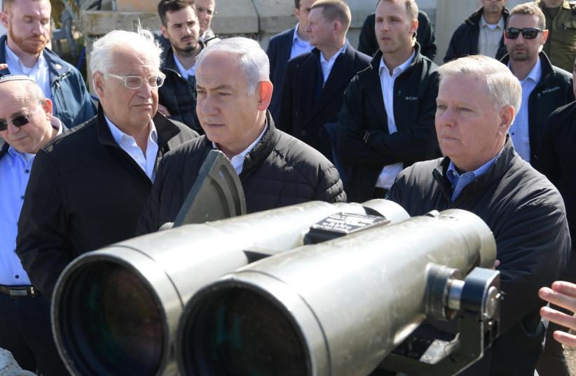 US Ambassador in Israel David Friedman, Prime Minister Benjamin Netanyahu and US Senator Lyndsey Graham [R – SC] on the Golan Heights March 11 2019.       (photo credit: AMOS BEN-GERSHOM/GPO)