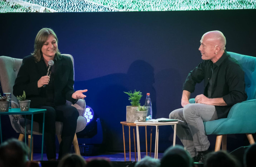 Keshet CEO Avi Nir speaks to Netflix VP Cindy Holland (photo credit: ODED KARNI)