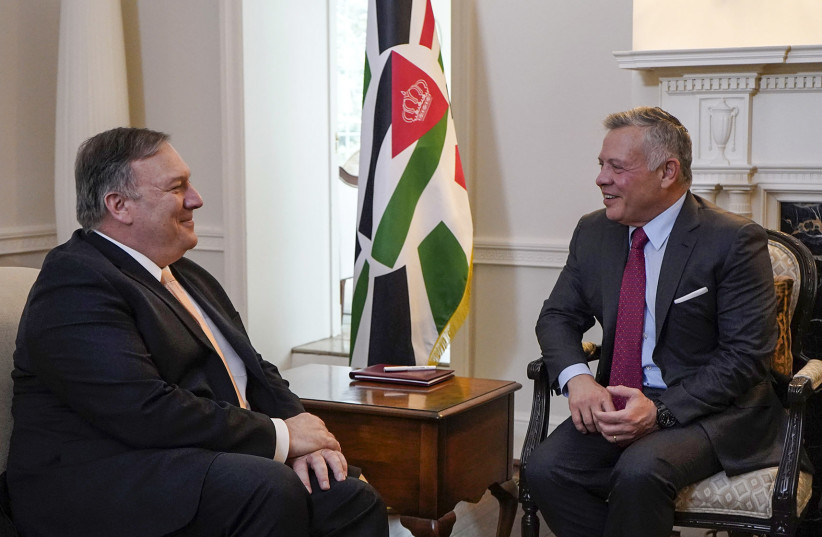 A handout picture released by the Jordanian Royal Palace on March 11, 2019 shows Jordanian King Abdullah II (R) meeting with US Secretary of State Mike Pompeo in Washington, DC (photo credit: YOUSEF ALLAN / JORDANIAN ROYAL PALACE / AFP)