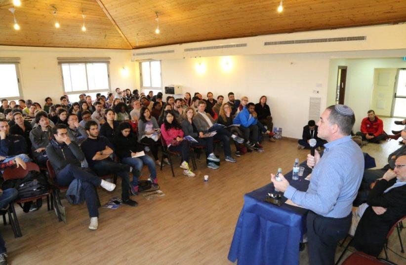 Oded Revivi speaks to a visiting delegation (photo credit: Courtesy)
