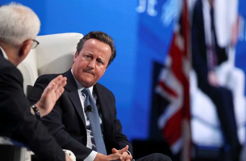 David M. Rubenstein (L), co-founder and co-chief executive officer at The Carlyle Group, holds a discussion with former British Prime Minister David Cameron during the SALT conference in Las Vegas, Nevada, U.S. May 17, 2017 (photo credit: REUTERS)
