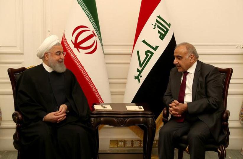 Iraq's Prime Minister Adel Abdul Mahdi meets Iranian President Hassan Rouhani in Baghdad, Iraq March 11, 2019 (photo credit: REUTERS)
