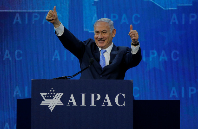 Prime Minister Benjamin Netanyahu speaks at the AIPAC policy conference in Washington, DC, U.S., March 6, 2018 (photo credit: BRIAN SNYDER/REUTERS)