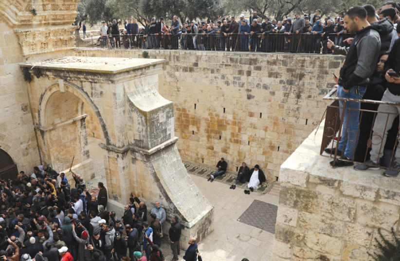 Palestinian Muslims enter the Golden Gate in Jerusalem's Old City on February 22, 2019 (photo credit: REUTERS)
