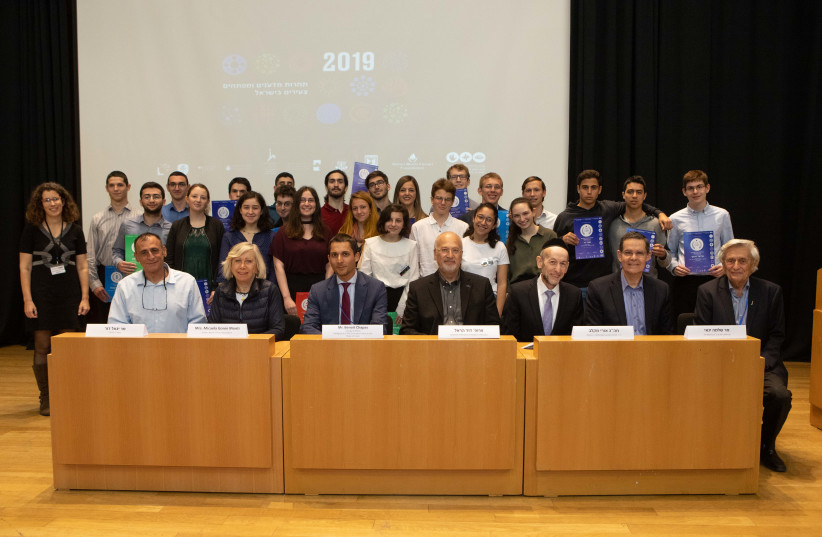 Winners, runners-up and the judging panel of the 22nd annual Israel Young Scientists and Developers Contest, March 12, 2019 (photo credit: YUVAL COHEN AHARONOV)