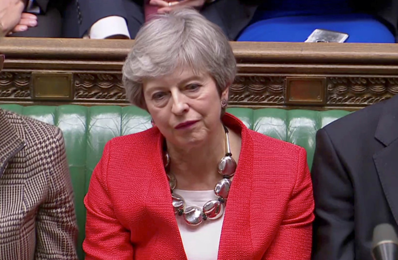 British Prime Minister Theresa May reacts after tellers announced the results of the vote Brexit deal in Parliament in London, Britain, March 12, 2019 (photo credit: REUTERS TV)