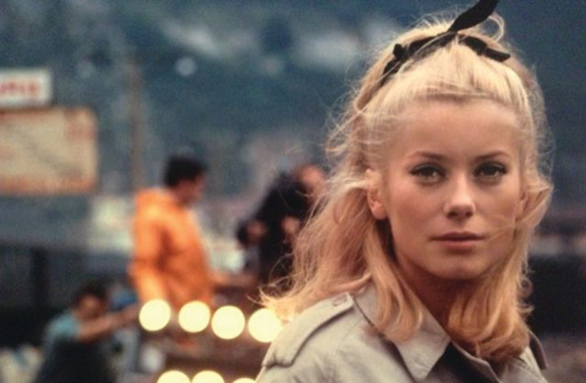 CATHERINE DENEUVE in Jacques Demy's 1964 classic 'The Umbrellas of Cherbourg' (photo credit: Courtesy)