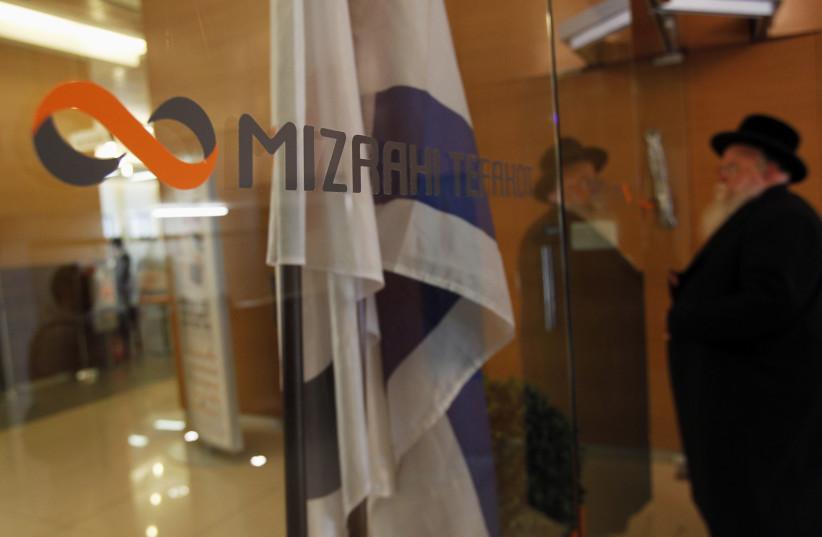A man enters a branch of Mizrahi-Tefahot Bank in Jerusalem August 29, 2011. (photo credit: REUTERS/BAZ RATNER)