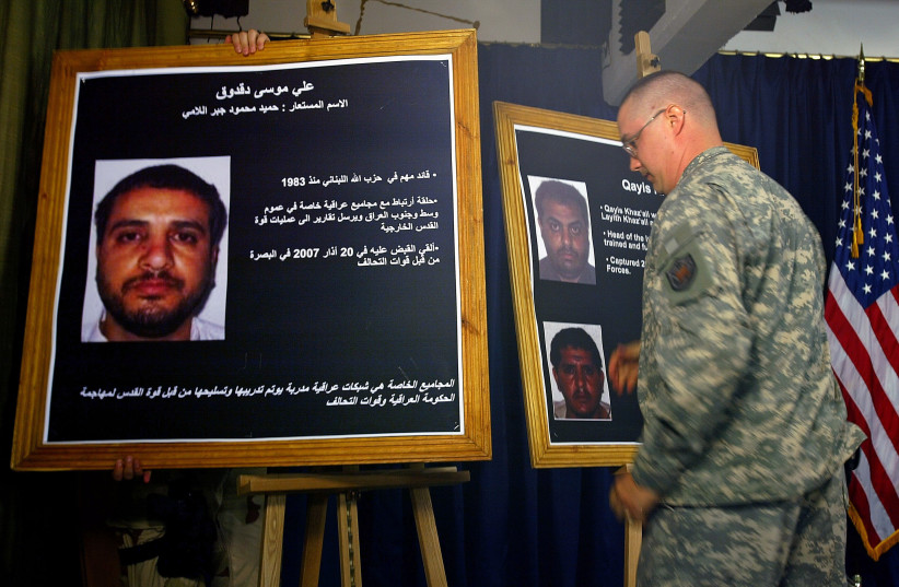 A U.S. solider shows a picture of Ali Mussa Daqduq during a news conference. (photo credit: REUTERS)