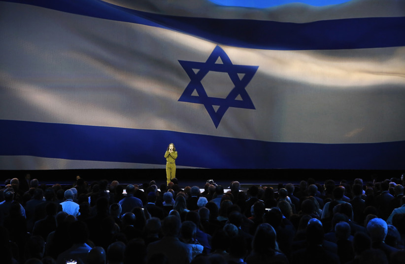Tamar Ben-Ozer of the Israeli Defense Forces (IDF) Outstanding Musicians program sings Israel's national anthem at the American Israel Public Affairs Committee (AIPAC) policy conference in Washington, March 1, 2015 (photo credit: JONATHAN ERNST / REUTERS)