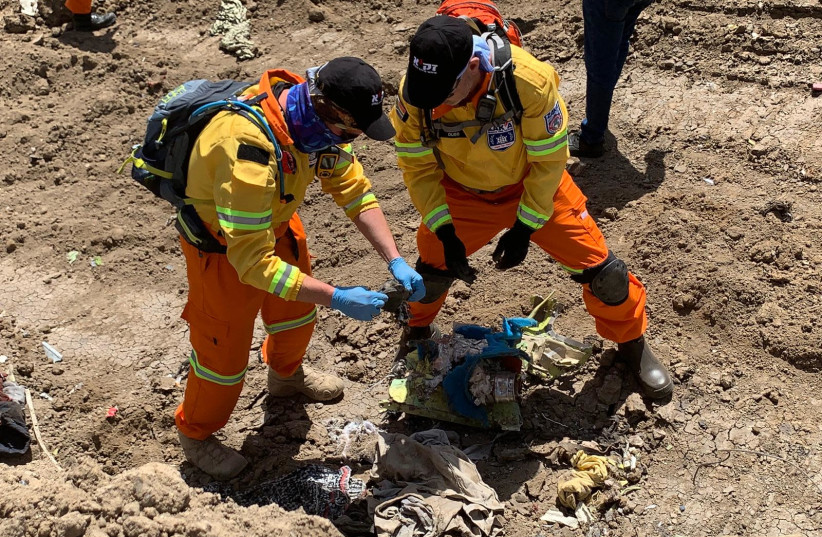 ZAKA volunteers search the crash site of Ethiopian Airlines Flight ET 302 for the remains of two Israeli victims (photo credit: ZAKA)