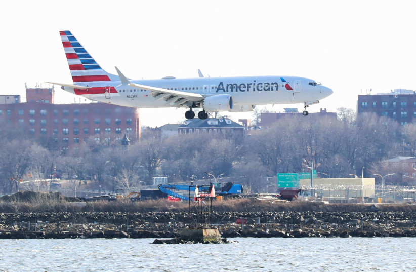 An American Airlines Boeing 737 Max 8, on a flight from Miami to New York City, comes in for landing at LaGuardia Airport in New York, U.S., March 12, 2019.  (photo credit: REUTERS/SHANNON STAPLETON)
