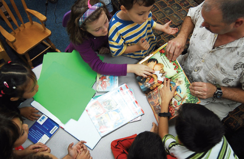 STORYTIME AT city libraries: Now free of charge. (photo credit: ILLUSTRATIVE PHOTO: WIKIMEDIA COMMONS)