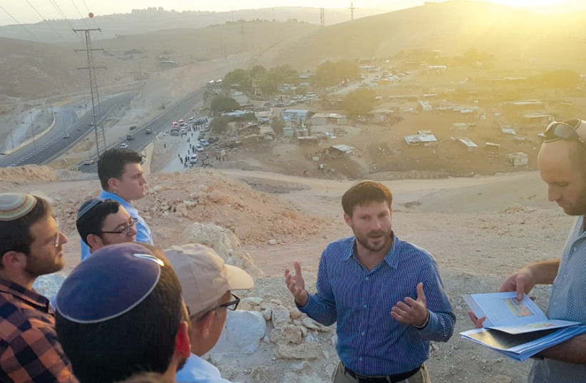 AT ILLEGAL West Bank Bedouin village Khan Al-Ahmar, advocating for its demolition in October. (photo credit: Courtesy)