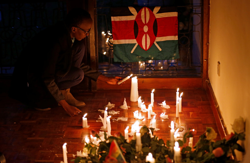 Muthoni Ngige, a member the Kenyan homosexual community pays tribute to the victims of the mass shooting at the Pulse gay nightclub in Orlando, U.S., in Kenya's capital Nairobi June 14, 2016 (photo credit: THOMAS MUKOYA / REUTERS)
